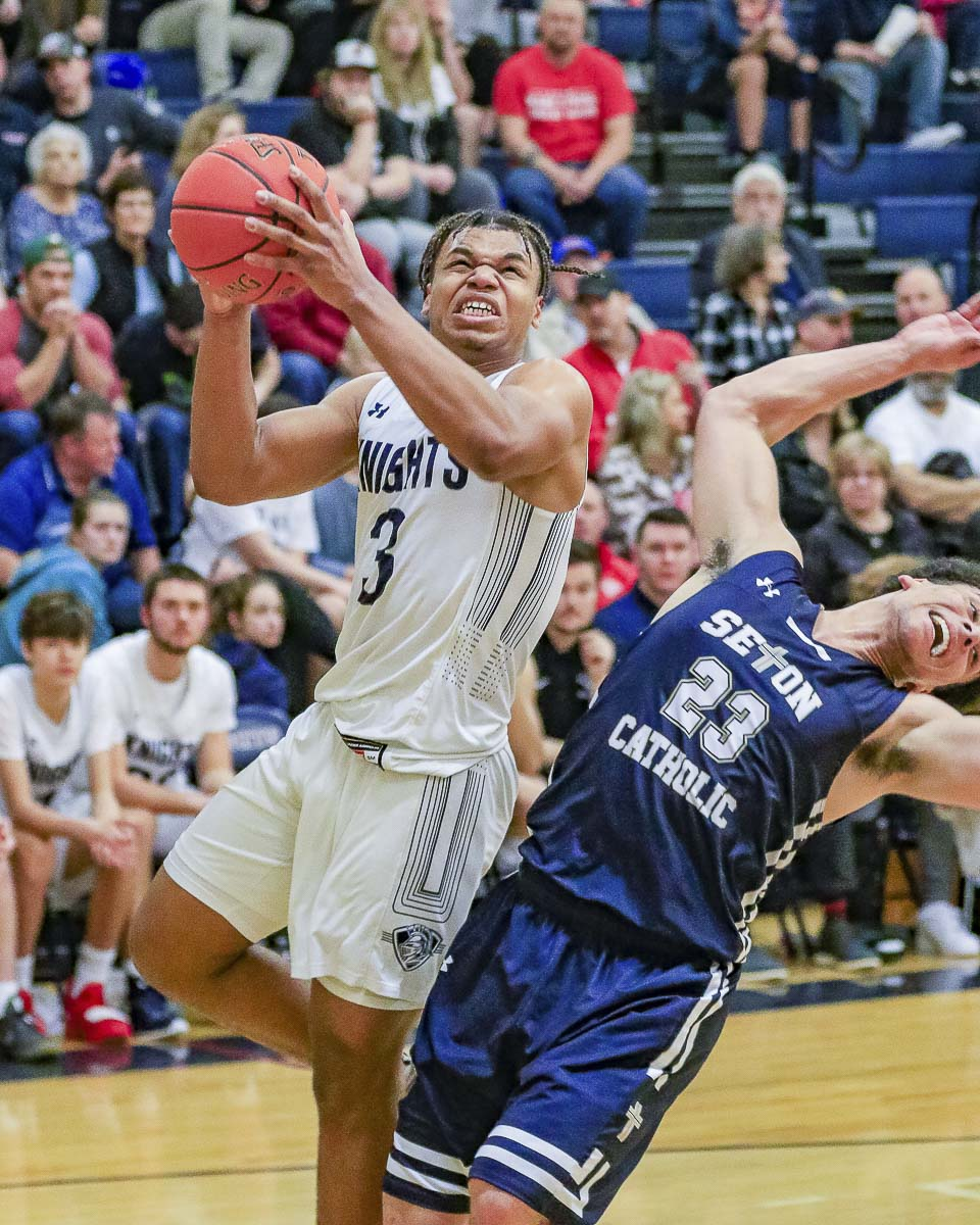 Kobi Cason of King's Way Christian gets past Gage Anderson on his way to the basket Friday. Cason scored 22 points, and Anderson had 20. King's Way prevailed 68-64. Photo by Mike Schultz
