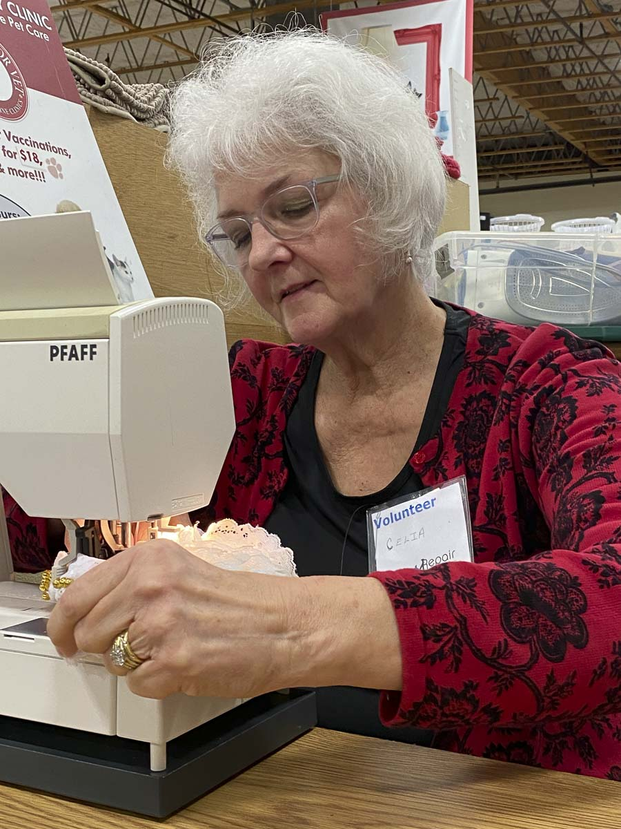Repair Clark County volunteer, Celia Cruz, working on a sewing project at the January event. Photo courtesy of Columbia Springs