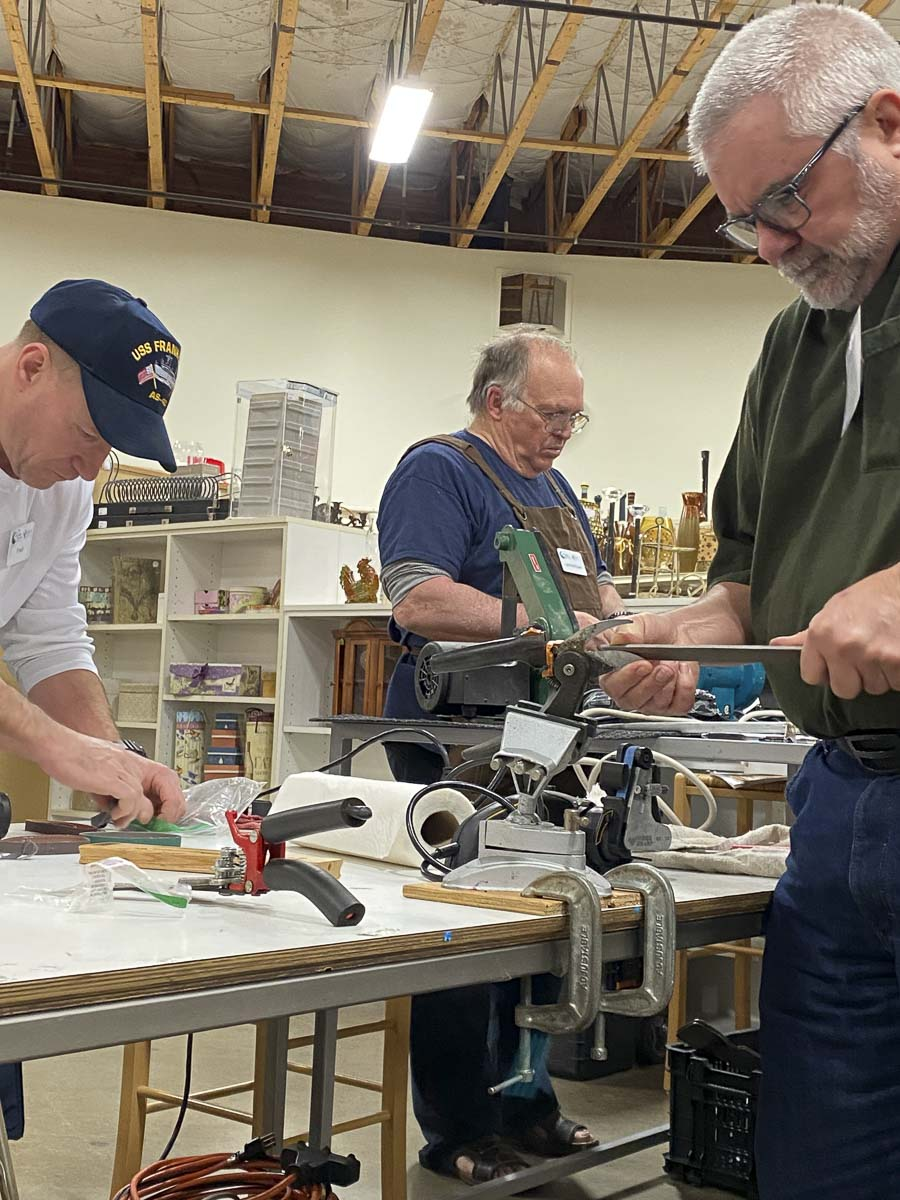 Repair Clark County volunteers Fred Davis, Les McKown and Zach Thomas sharpen dull knives and tools at the January repair event. Photo courtesy of Columbia Springs