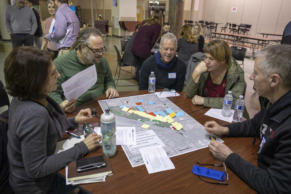 (From left to right) Camas residents Lynne Lyne, Scott Hogg, Randy Sedlak-Ford, Lyn Sedlak-Ford, and Dan Lyne work on an exercise of laying out classification for the development they'd like to see in North Shore. Photo by Jacob Granneman