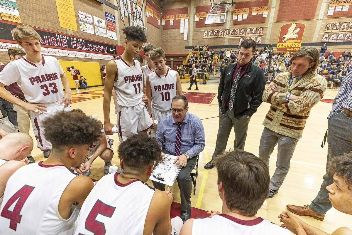 Prairie High School boys basketball coach Kyle Brooks (seated with clipboard) is shown here coaching his team during a playoff game last season. Brooks has been hospitalized since Jan. 3 while battling the symptoms of Guillain-Barré syndrome. Photo by Mike Schultz