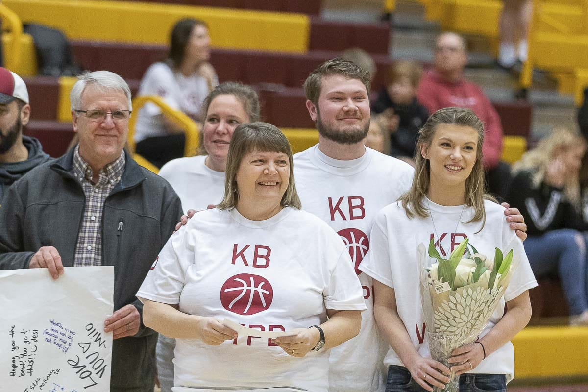 Jane Brooks (front center) is shown here during Thursday's tribute to her husband Kyle prior to Prairie's district tournament game. Also pictured, are Kyle and Jane's son Preston (second from right) and wife Brittany (far right). Photo by Mike Schultz