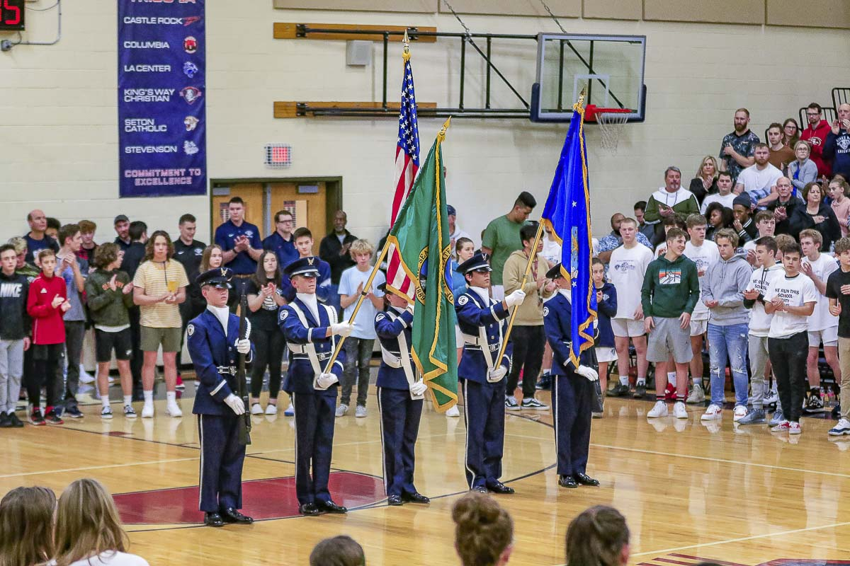 The students from both schools circled the color guard as King's Way Christian and Seton Catholic held a military appreciation night Friday in a basketball doubleheader at King's Way. Photo by Mike Schultz