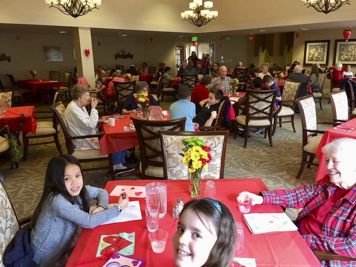 South Ridge Elementary fourth graders enjoy Valentine's Day lunch with their senior friends at Highgate Senior Living Center. Photo courtesy of Ridgefield Public Schools