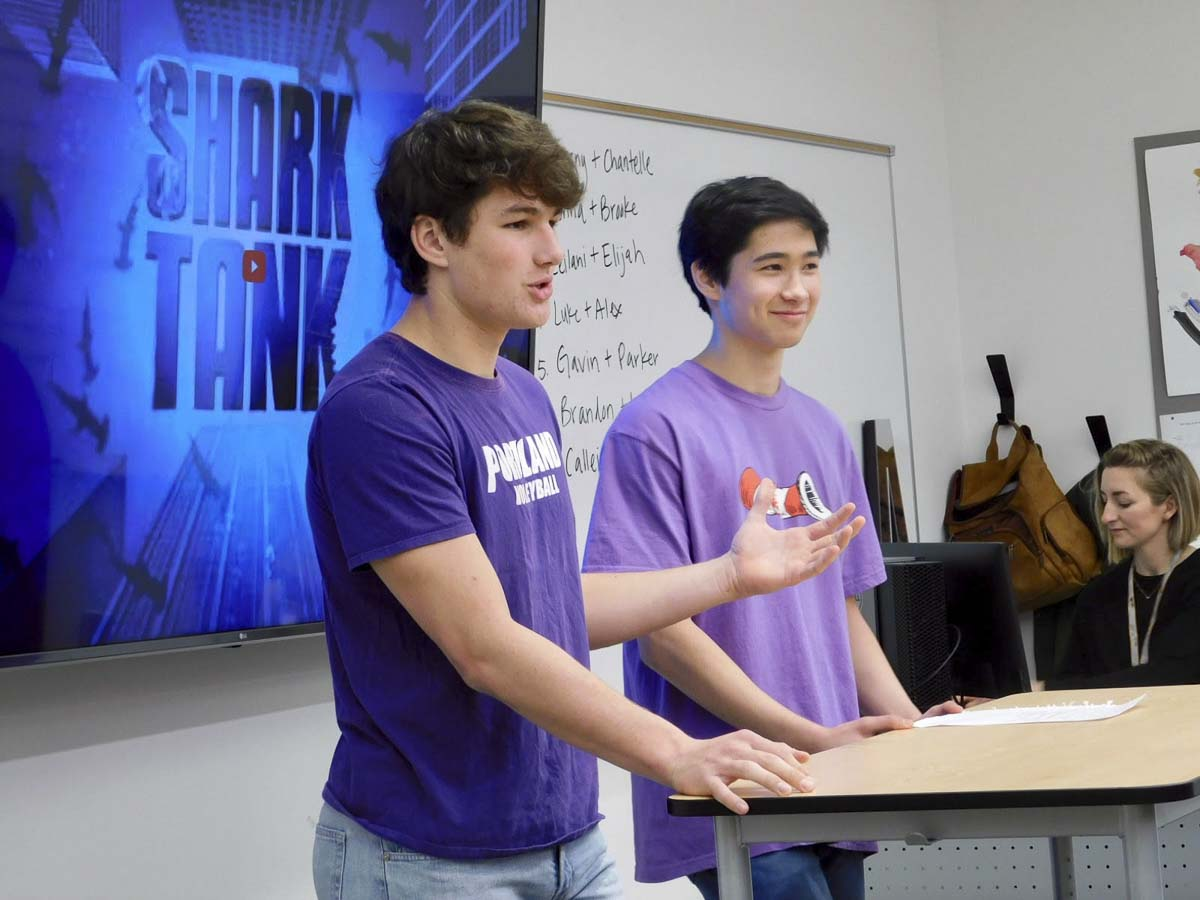 Ridgefield High School students Luke Price and Alex Fulton explain their toothpaste concept, Purple Plaque Attack, to the Shark Tank panel. Photo courtesy of Ridgefield Public Schools