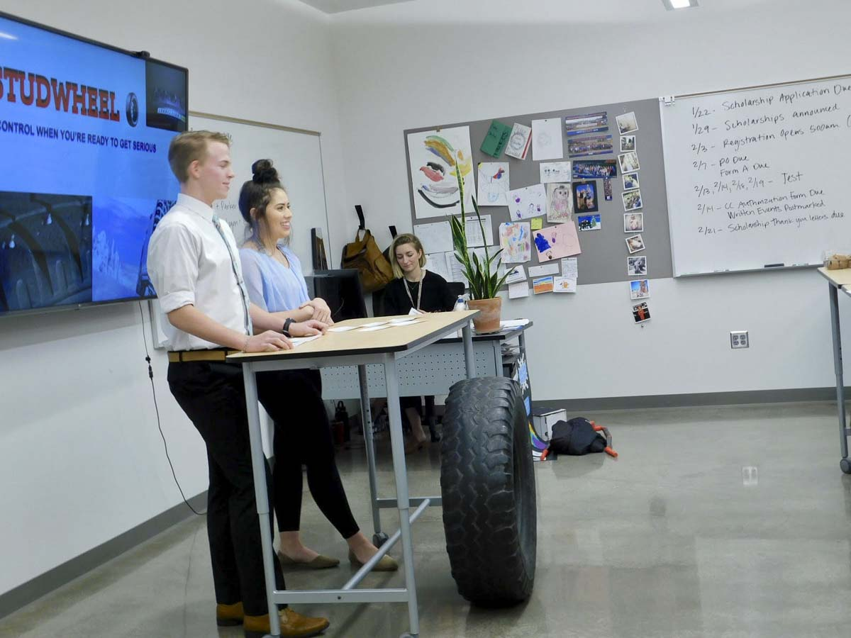 Ridgefield High School students Elijah Engstrom and Leilani Starns pitch their concept to the Shark Tank panel for tires with retractable studs. Photo courtesy of Ridgefield Public Schools