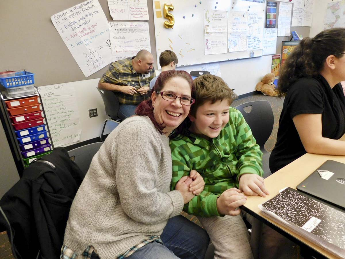 Kristi and Chase Evans join other parents and students researching rainforests at Sunset Ridge Intermediate School. Photo courtesy of Ridgefield Public Schools