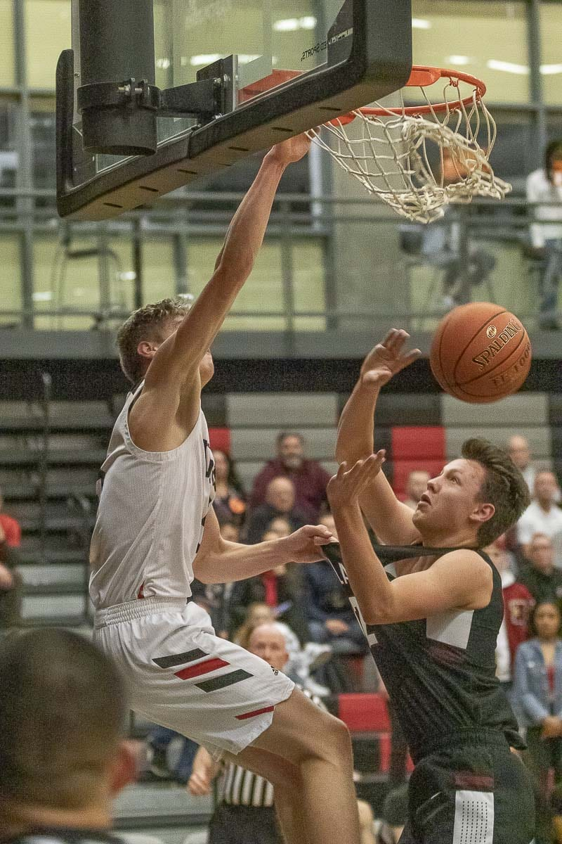 Union's Tanner Toolson (5) finishes off a dunk during the Titans' 75-56 win over Kentlake Wednesday at Union High School. Photo by Mike Schultz