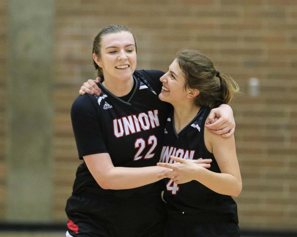Mackenzie Lewis (22) and Mason Oberg (4) are all smiles after helping Union to a seven-seed for the upcoming Class 4A state girls basketball regional round. Photo by Mike Schultz