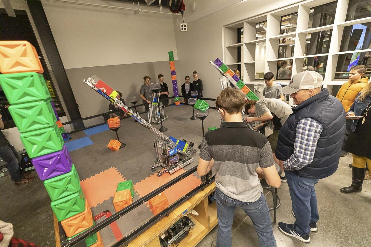 iTech Prep students are seen here demonstrating their robotics project to parents and community members at the iTech dedication this week. Photo by Mike Schultz