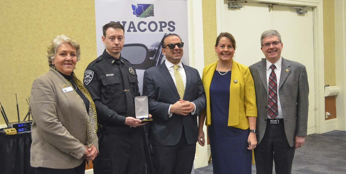 On Wednesday, the Washington Council of Police & Sheriffs named Washougal Police Officer Francis Reagan (second from left), Officer of the Year for a heroic water rescue on the Washougal River in May 2019. Shown here with Reagan are (left to right) Washougal Mayor Molly Coston, Reagan, Lt. Gov. Cyrus Habib, Sen. Ann Rivers and Washougal City Administrator David Scott. Photo courtesy of city of Washougal