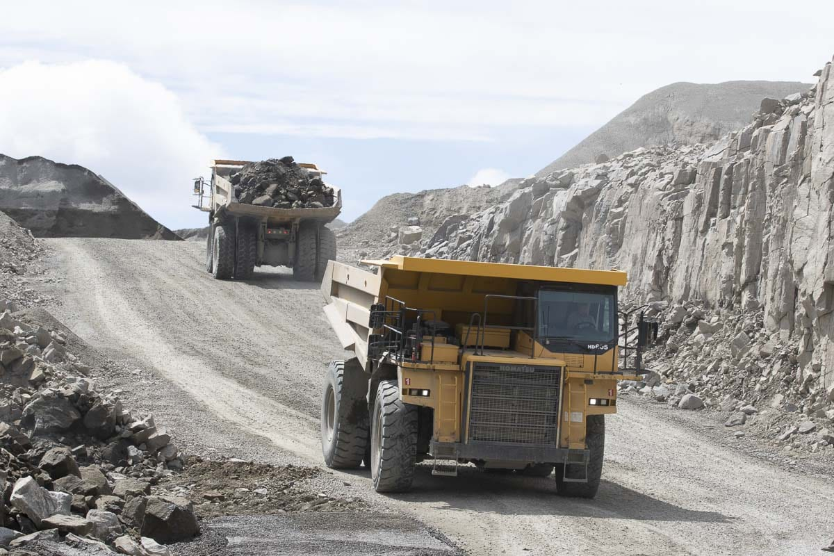 Dump trucks at the Yacolt Mountain Quarry move raw aggregate out of the main pit and to the crusher for processing. Photo by Mike Schultz