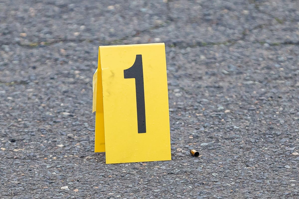 Markers show the location of shell casings in the parking lot of a business at Fourth Plain and Stapleton Road after a deadly shooting Tuesday afternoon. Photo by Mike Schultz