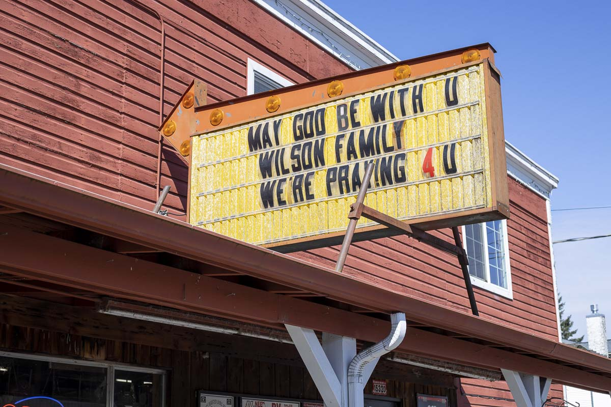 A sign outside the Brush Prairie General Store wishes the family of Rosa and Brian Wilson well after Rosa and the couple's 5-year old daughter were killed last Friday during a head-on crash on nearby SR-503. Photo by Chris Brown