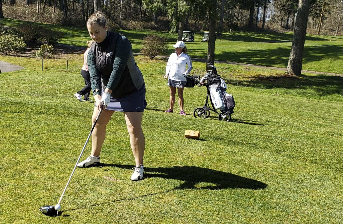 Jamie Stilwell sets up for her shot on the first tee at Camas Meadows Golf Course on Thursday. She said she needed to get out for some fresh air and was grateful that the course was open. Photo by Paul Valencia