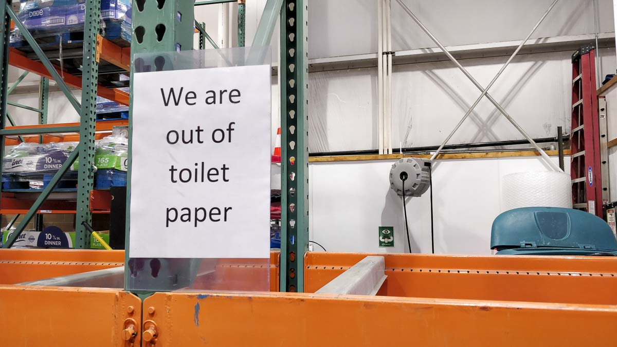Signs inform shoppers at the Costco on Andresen Road in Vancouver that toilet paper has been sold out. Photo by Chris Brown