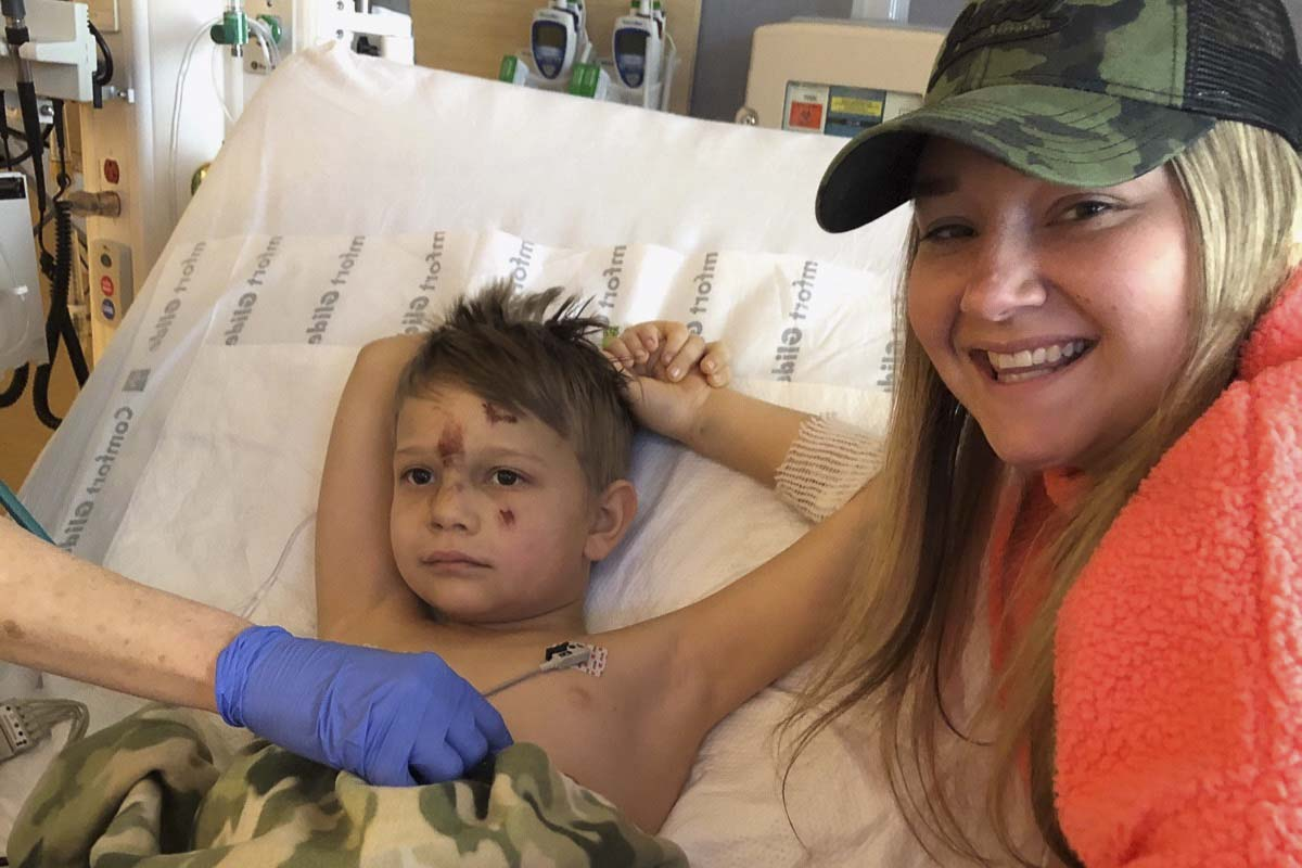 Samantha Joy, the sister of Rosa Wilson, poses with 7-year-old Elliott, who was injured during Friday's head-on crash along SR-503 in Brush Prairie. Photo courtesy Wilson Family