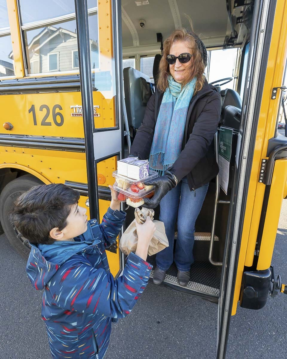 Kathy Young said she was overjoyed to help deliver food to students on her bus route. Photo by Mike Schultz