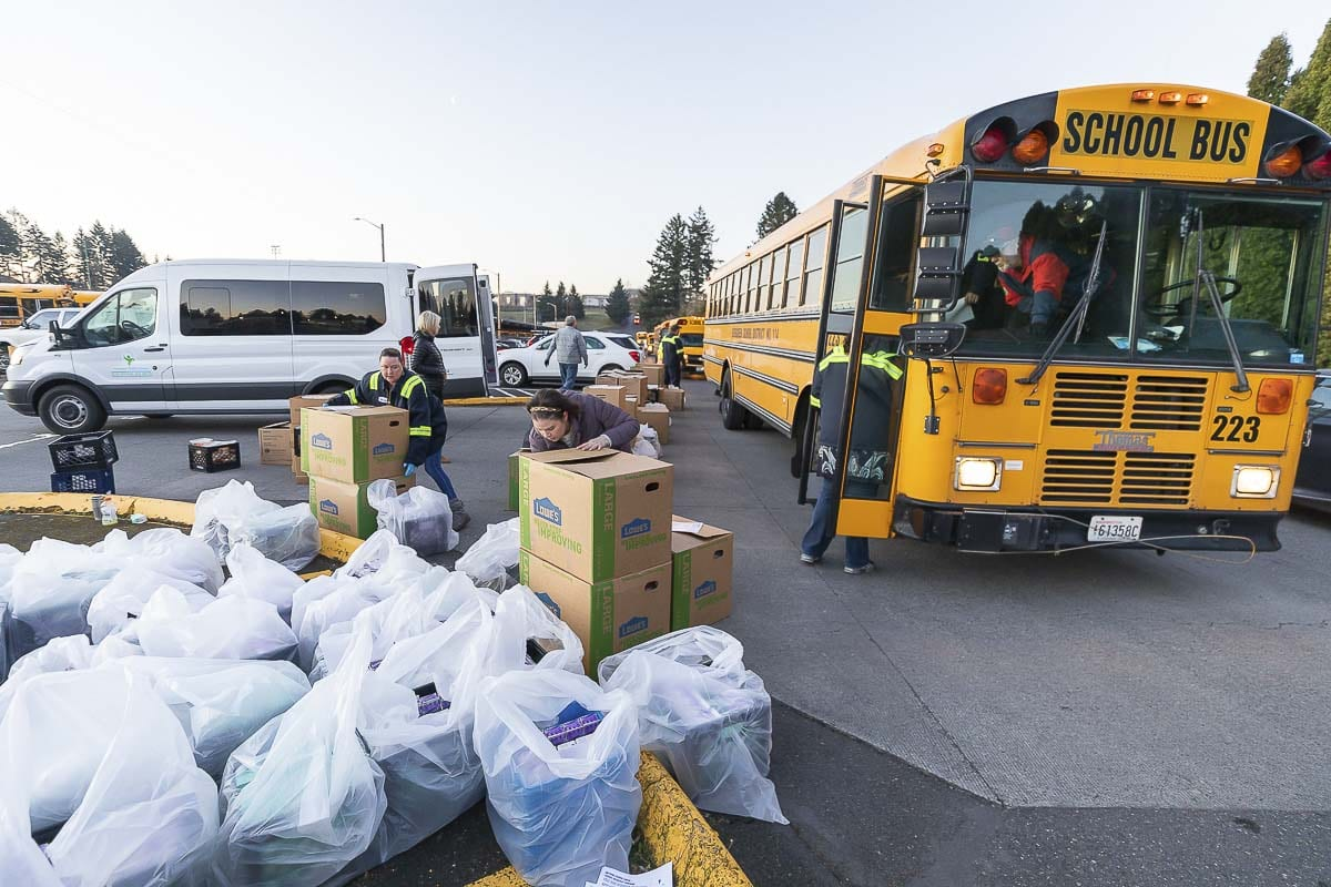 Buses line up to have food loaded Tuesday morning before drivers went out on their routes. Photo by Mike Schultz