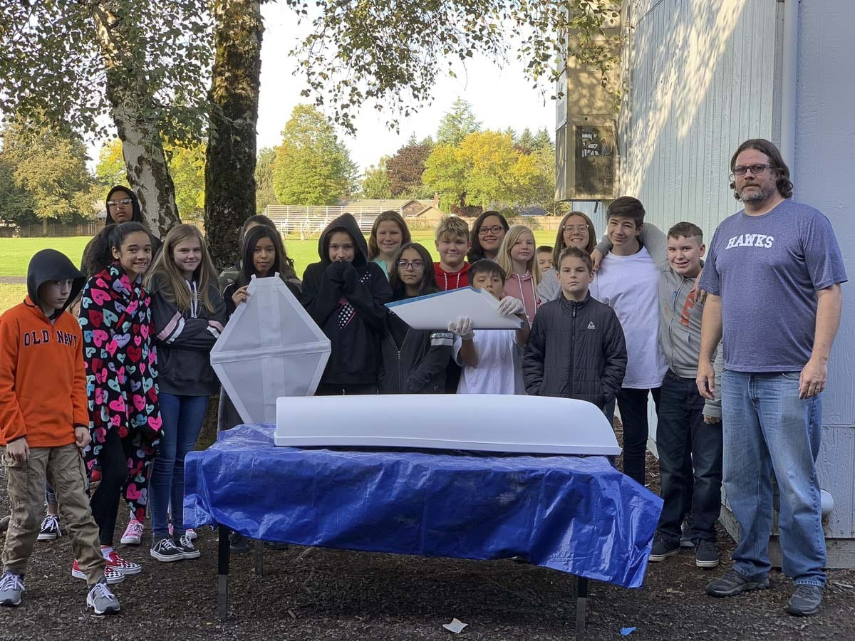 Joe Boken's seventh grade science class at Wy'east Middle School pose with their mini-boat to be sent to their sister school in Japan. Photo courtesy Columbia River Maritime Museum