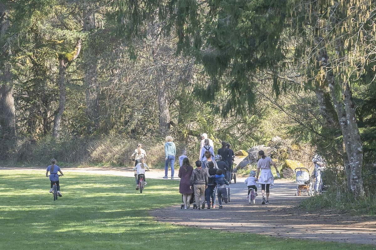 People are seen here walking the trails in Lewisville Park in Battle Ground. No parks are closed yet, due to COVID-19, but the public health department has cautioned area residents to practice social distancing. Photo by Mike Schultz
