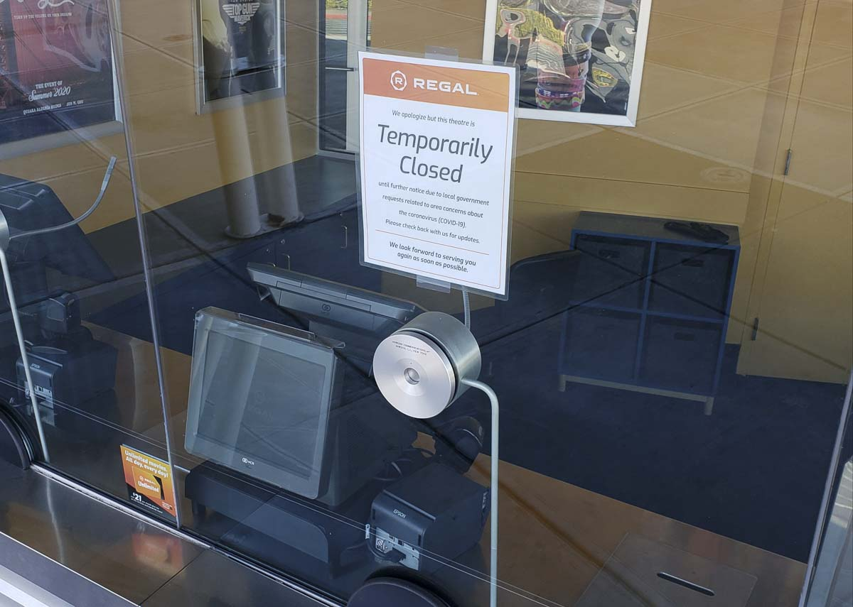 A sign posted at the box office at Regal Cascade movie theater tells movie goers that the theater is temporarily closed. Photo by Paul Valencia