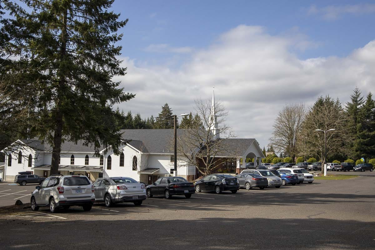 People waited in cars, watching a funeral for Rosa and Juniper Wilson on a live stream, due to restrictions on large gatherings in Washington state. Photo by Chris Brown