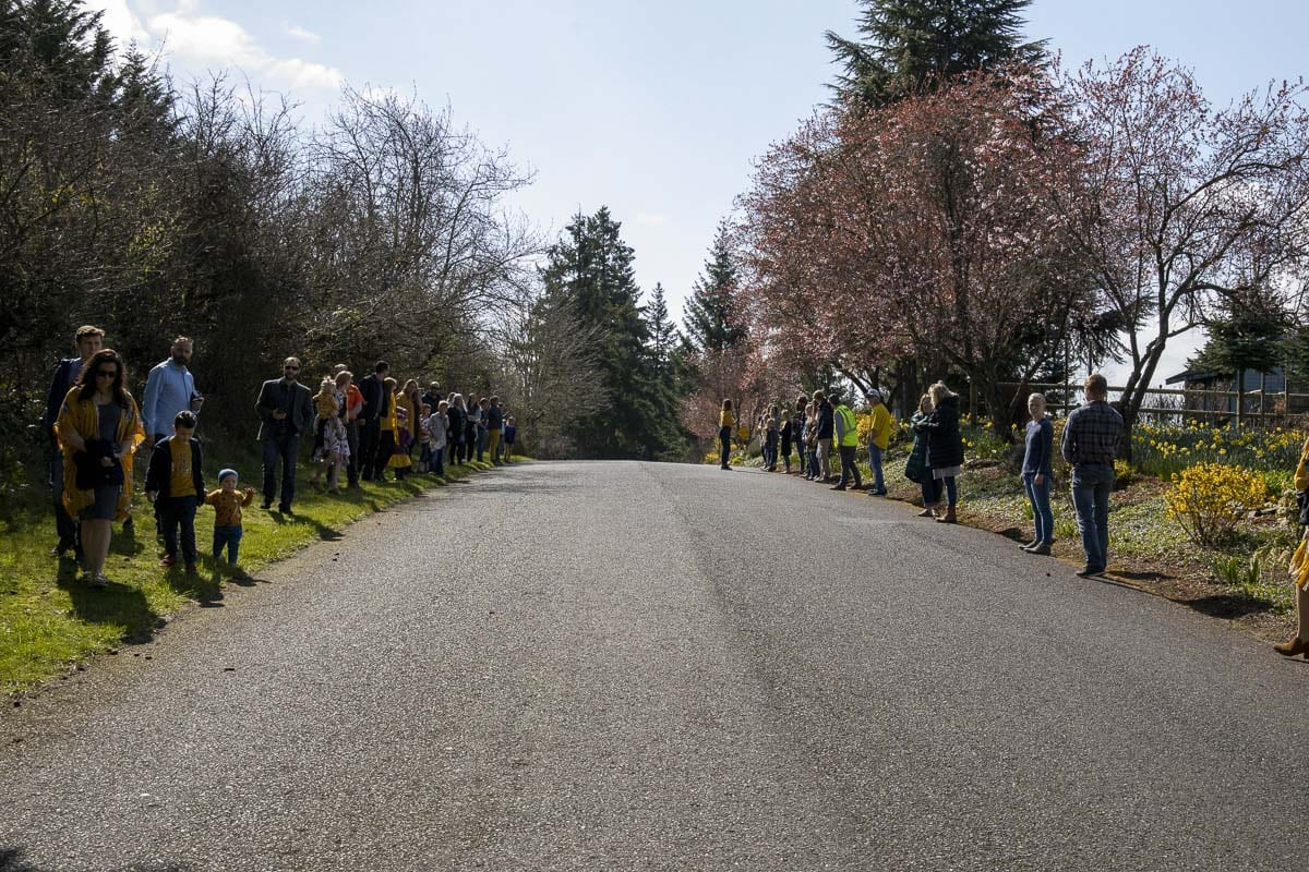 Hundreds lined up from the driveway of Hockinson Apostolic Lutheran Church down NE 164th Street to 182nd Avenue on Wednesday to honor Rosa and Juniper Wilson, killed earlier this month in a head-on car crash. Photo by Chris Brown