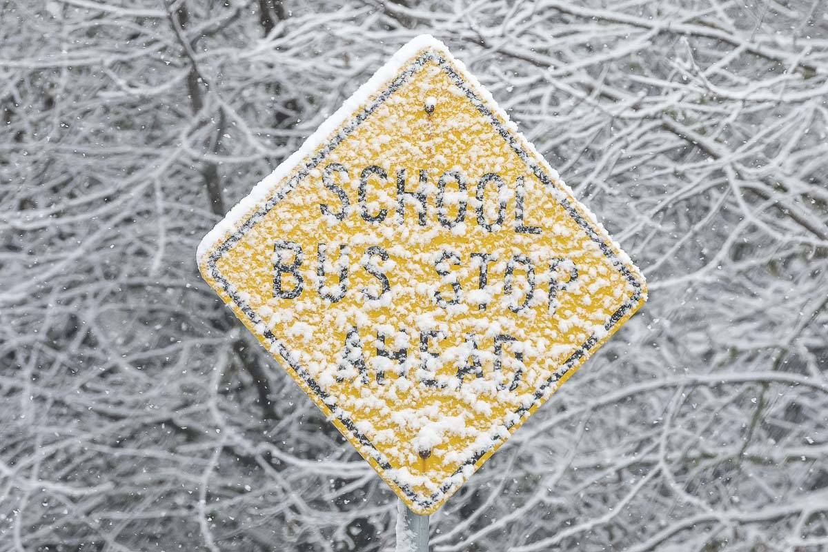 Snow blankets a school bus stop sign along Kelly Road in Yacolt Saturday morning. Photo by Mike Schultz