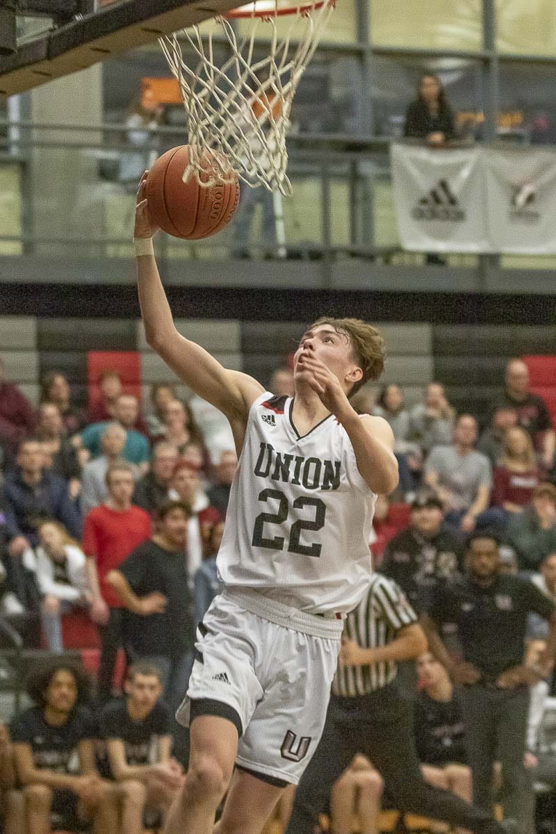 Kaden Horn, shown here earlier this season, made five 3-pointers and scored 24 points Thursday, helping Union to a 69-56 win over Olympia in the Class 4A boys basketball state tournament in the Tacoma Dome. Photo by Mike Schultz