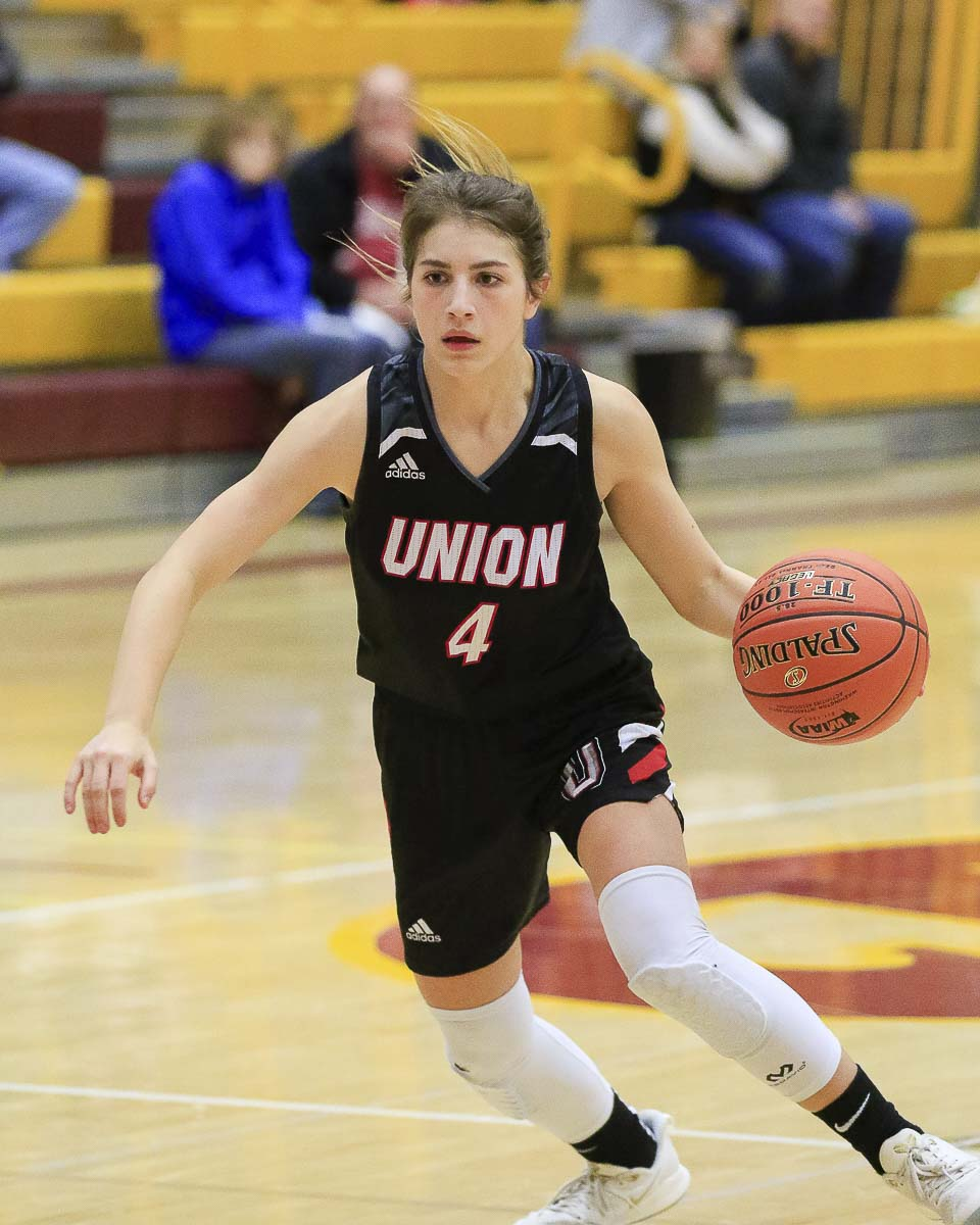 Union's Mason Oberg, shown here earlier this season, scored 17 points and had the go-ahead basket Thursday, leading the Union Titans to the Class 4A state girls basketball semifinals. Photo by Mike Schultz
