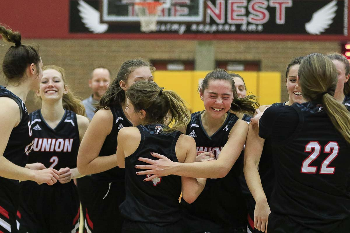 The Union girls have reason to celebrate. Their victory on Saturday advanced them to the 4A state quarterfinals this week in the Tacoma Dome. Photo by Mike Schultz