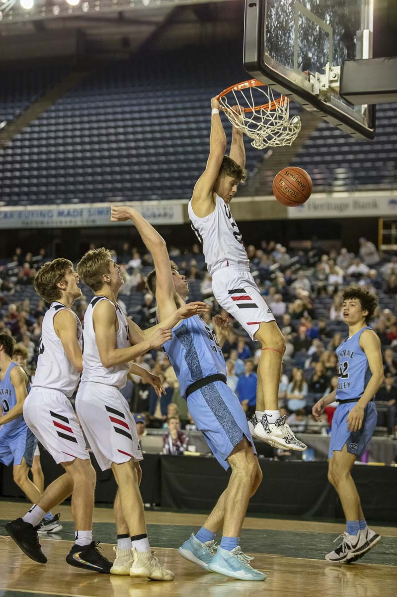 Josh Reznick slams one home after an offensive rebound during Union's rally in the fourth quarter Friday. The rally would fall short, though. Central Valley beat Union in the 4A boys state semifinals. Photo courtesy Heather Tianen