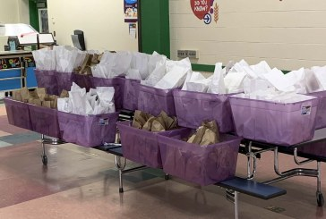 Woodland Public Schools staff packs and delivers nearly 1,600 meals for area children in need