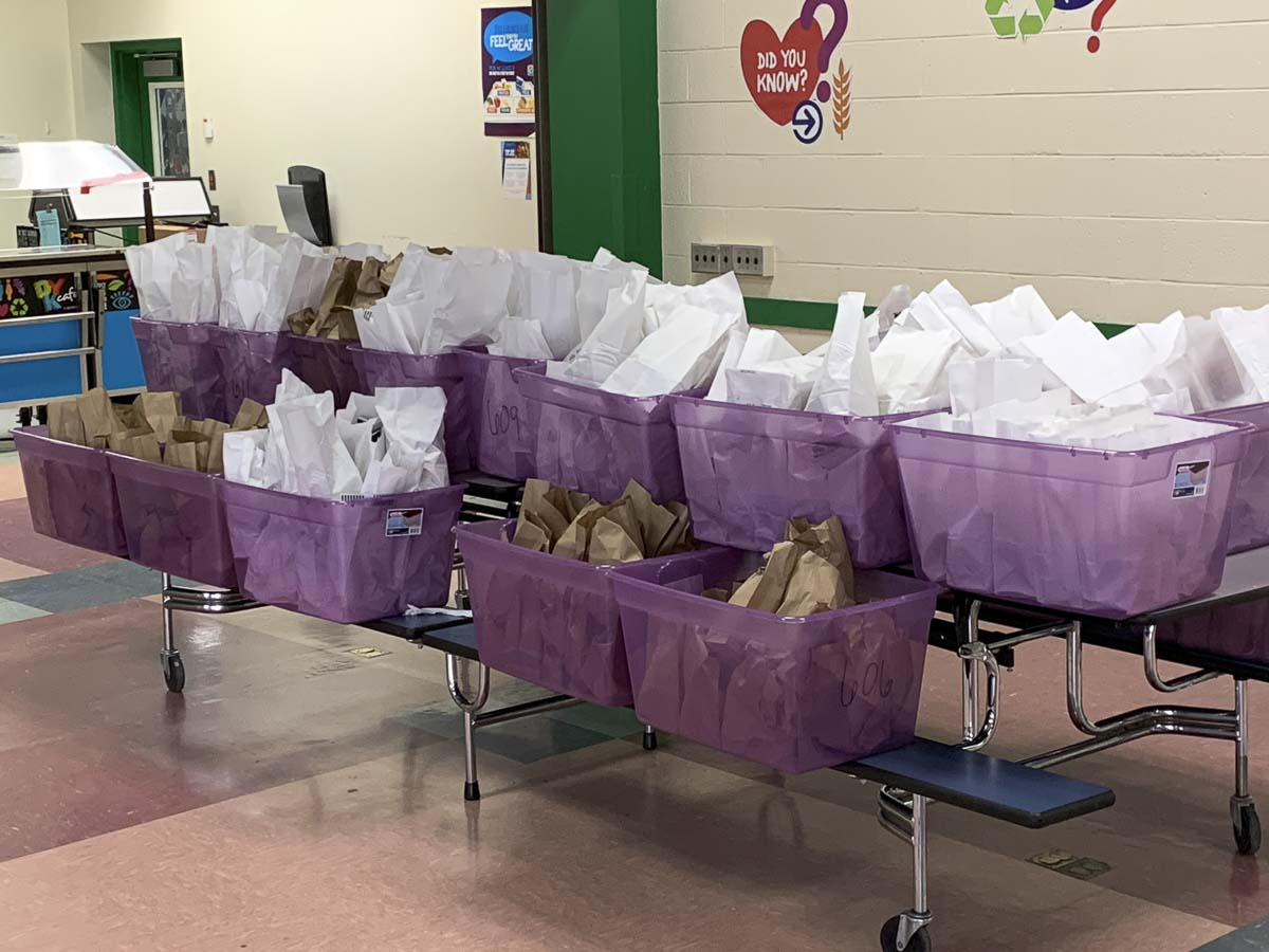 Woodland Public Schools staff packed and delivered nearly 800 bags with breakfast and lunch. Photo courtesy of Woodland Public Schools