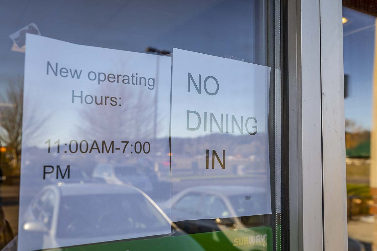 This sign in the window of a Woodland Subway restaurant is similar to many all over Clark County in the midst of a viral pandemic. Photo by Mike Schultz