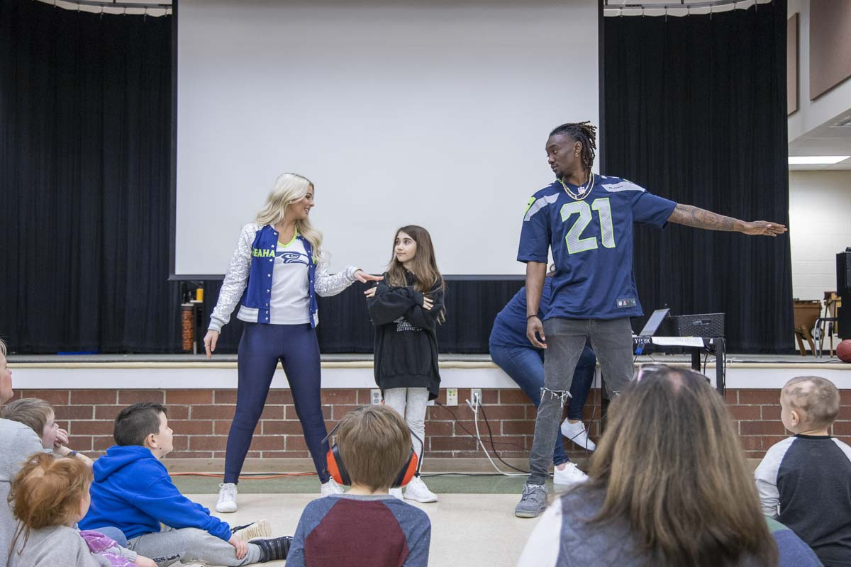 York Elementary student Lily Brasket teaches popular Tik Tok dance moves to Seahawks Dancer Kylie and Cornerback Trey Flowers at an event on Monday. Photo by Chris Brown