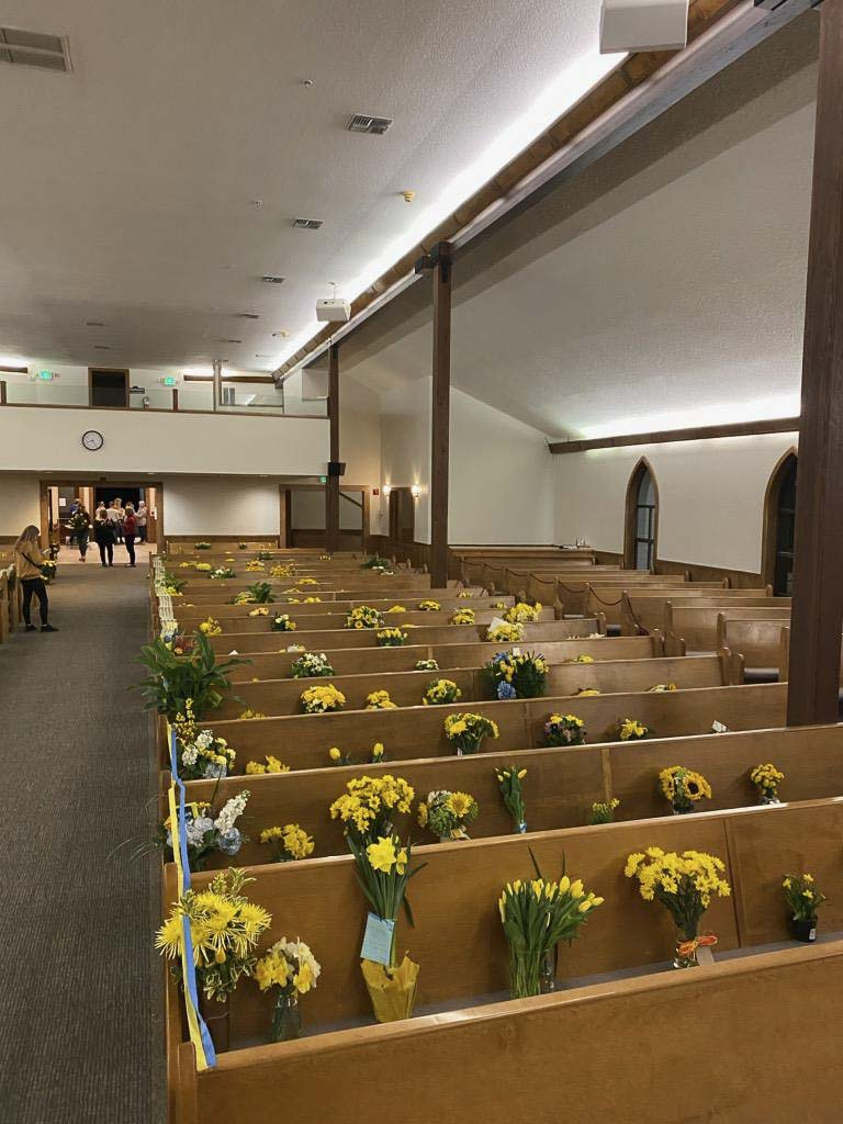 Yellow flowers filled the seats at Hockinson Apostolic Lutheran Church during the funeral for Rosa and Juniper Wilson, due to a restriction on gatherings of more than 50 people in Washington state. Photo courtesy Hockinson Apostolic Lutheran Church