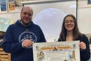 Mini-boat students receive Navy certificate after their vessel crosses international dateline