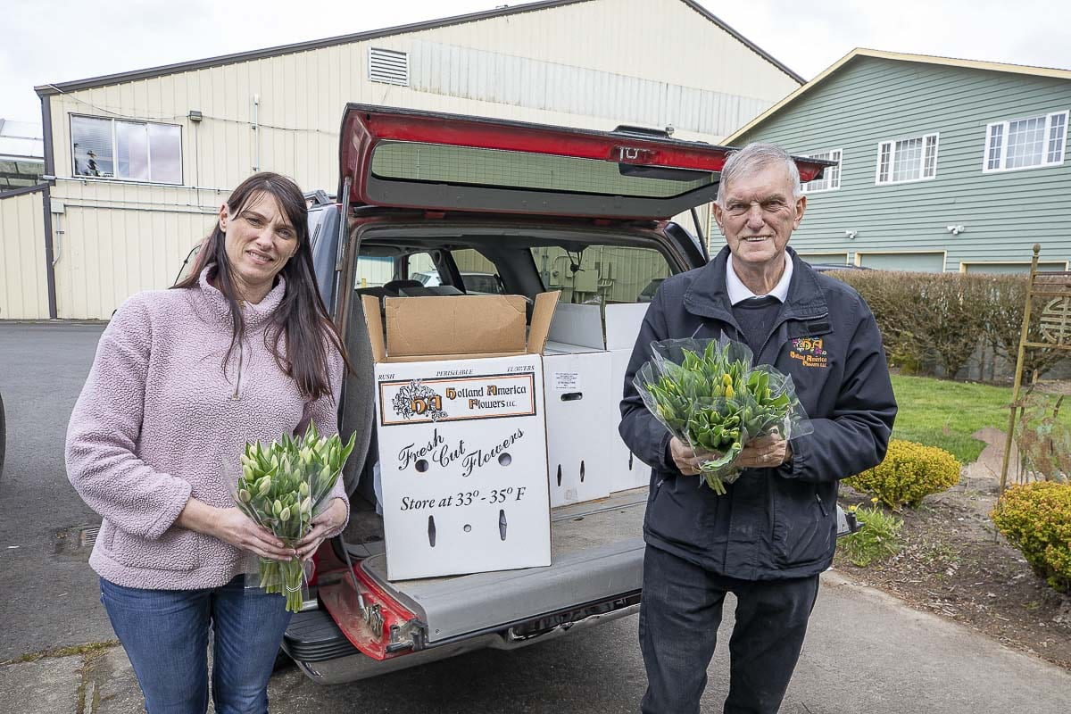 Benno Dobbe (right) and his daughter Nicolette (left) are seen here loading flowers into a truck for delivery to local hospitals and care facilities. Photo by Mike Schultz