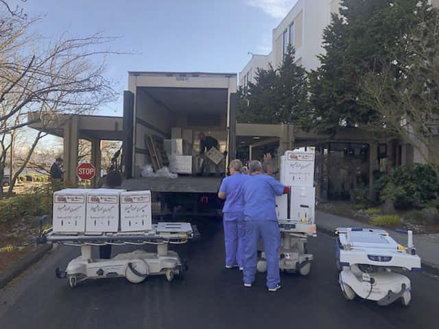 Helpers unload thousands of flowers at PeaceHealth Southwest Medical Center this week. Photo by Kristy Murray