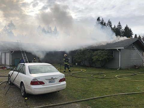 Firefighters stretched hoselines to attack the fire from the outside before heading inside the house to finish extinguishing the fire, which took 24 minutes. Photo courtesy of Vancouver Fire Department
