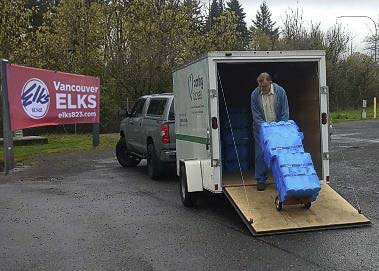 A volunteer from IITRN (In It Together RN) is shown here loading his trailer with toilet paper at the Vancouver Elks Lodge. Photo courtesy of Vancouver Elks Lodge #823