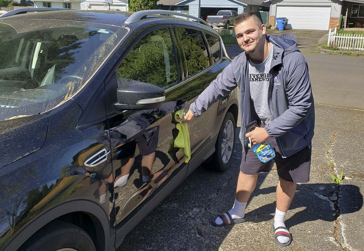 Cade Gardner wants to wash your car for free. Exterior only, while maintaining social distancing. He just wants to do something to help out the community. Photo by Paul Valencia