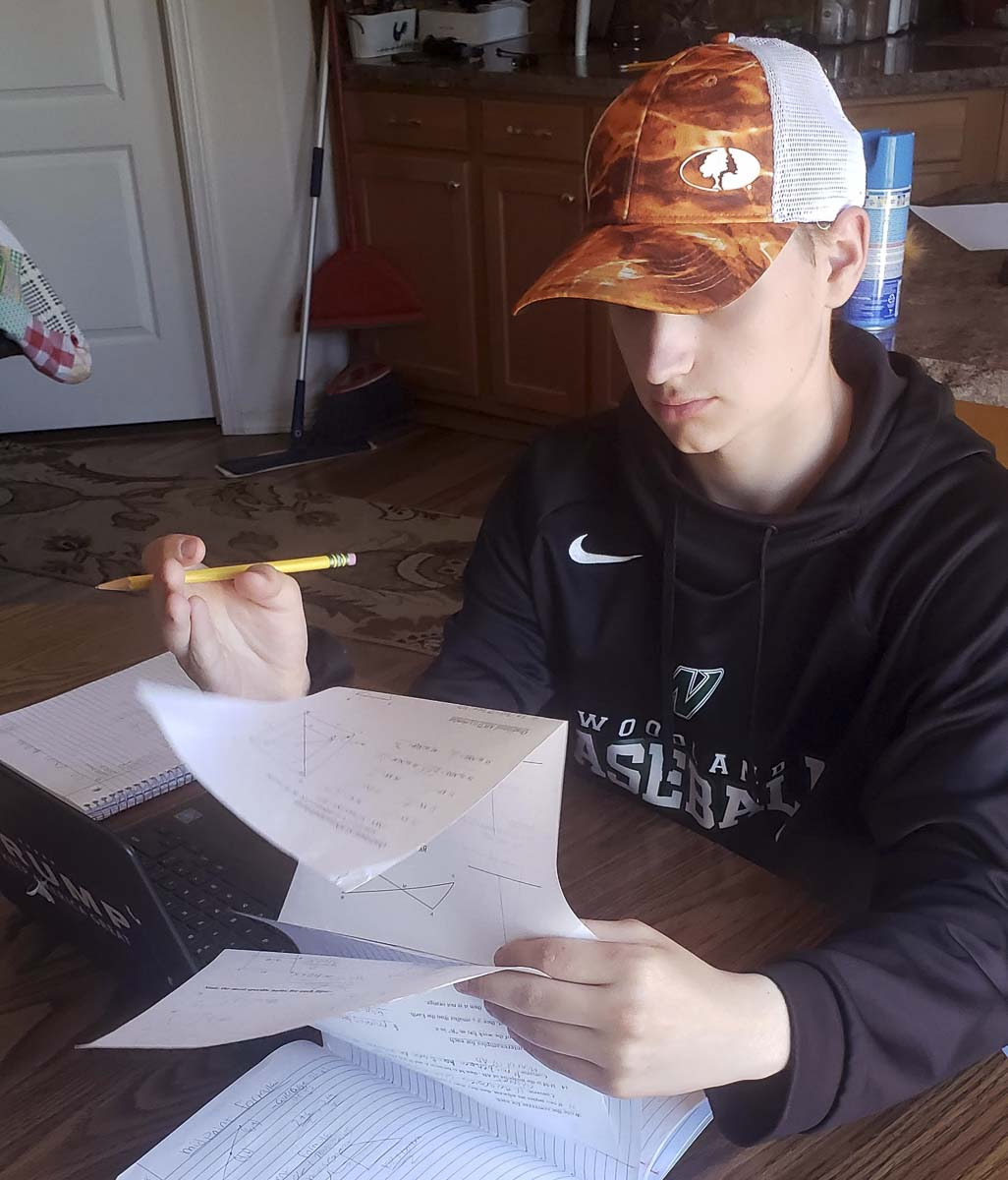 Colton Hall, a tenth grader at Woodland High School, works on a math test at home. Photo courtesy of Woodland Public Schools