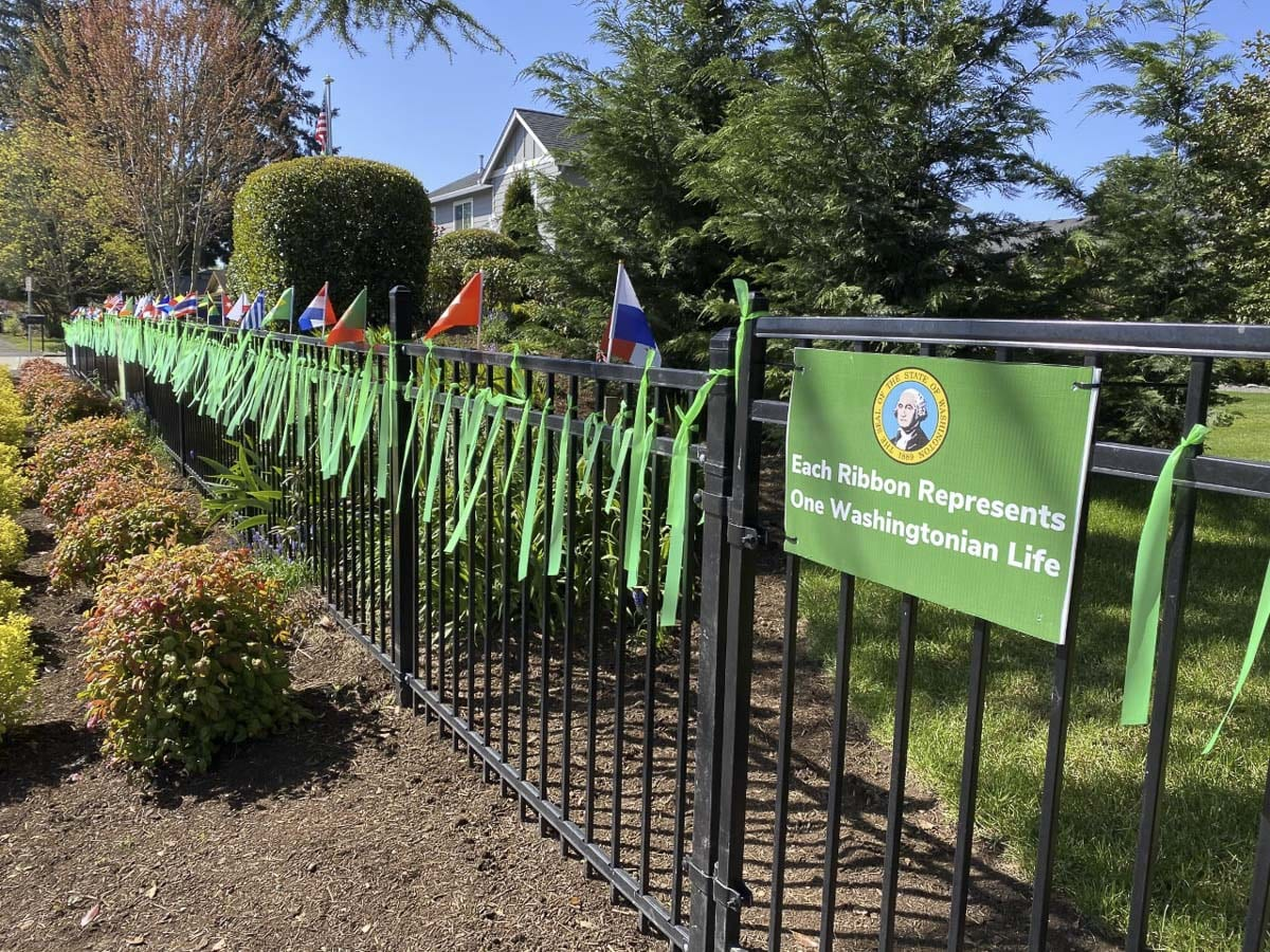 Jim Mains and his son, Remington, have been hanging green ribbons outside their Vancouver home. One for every victim of COVID-19 in Washington state. Photo courtesy Jim Mains