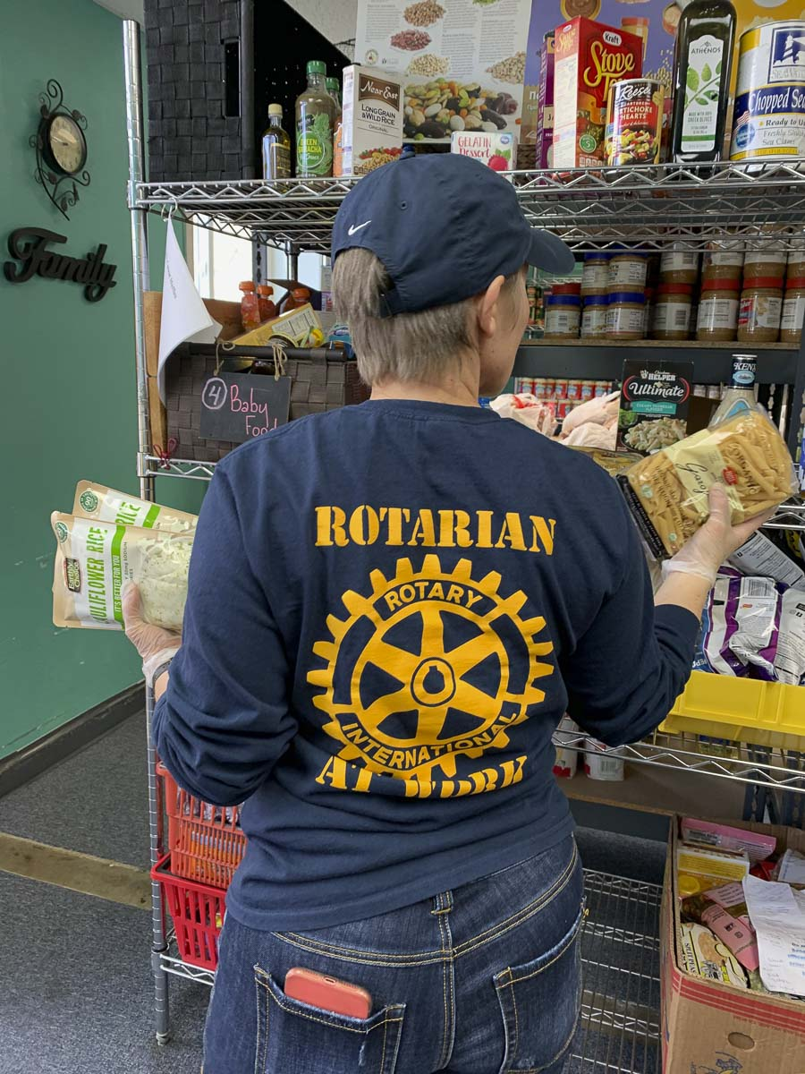 Susanne Holmberg stocks pasta shelves at North County Community Food Bank in Battle Ground. Photo courtesy of The Rotary Club of Three Creeks
