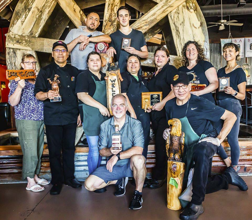 Owner Russell Brent (pictured, front center) said he and a skeleton crew at Mill Creek Pub will empty out all of the walk-ins at his restaurant and prepare food boxes for some churches in the area. The churches will be picking up the boxes and delivering them to the doorsteps of some of those in need. Photo courtesy of Mill Creek Pub