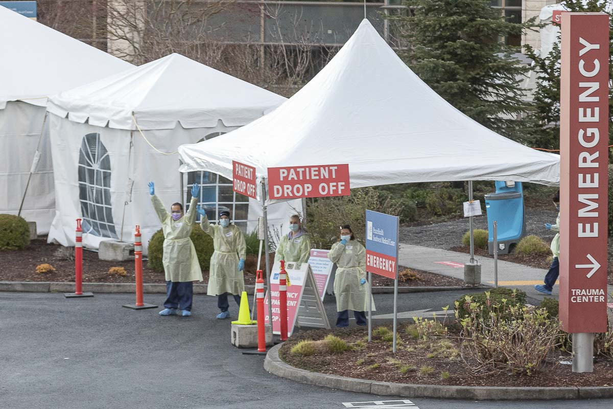 Nurses working the emergency department check-in area at PeaceHealth Southwest Medical Center acknowledge hundreds of people who showed up Wednesday to say thank you. Photo by Mike Schultz