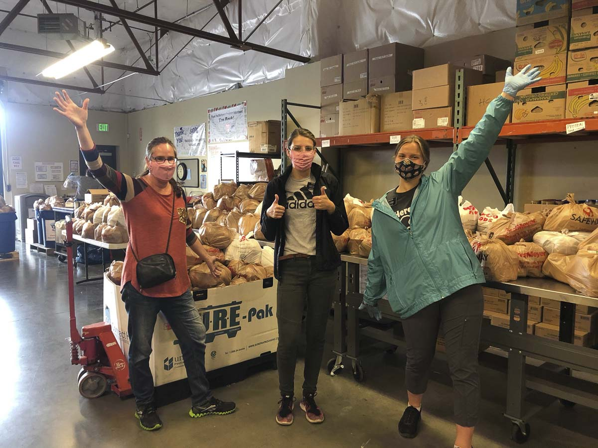 Volunteers wear PPEs while sorting food and serving hot meals as part of Share's response to the crisis. Photo courtesy of Share Vancouver